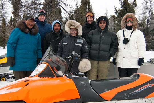 team around a snow mobile